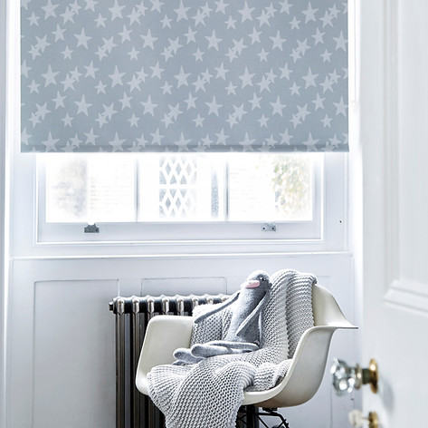 Light gray star patterned roller blinds