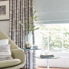 Light gray roman blinds