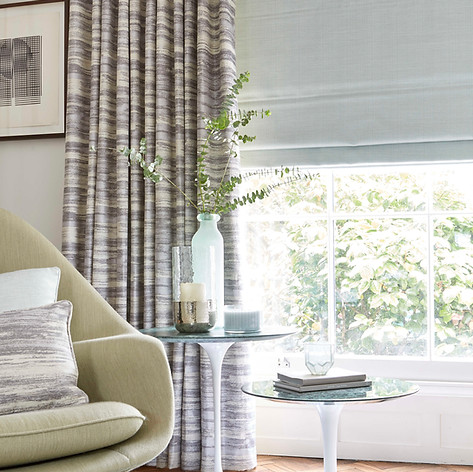 Light gray roman blinds