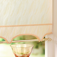 Cream colonnade scallop with a cream braiding and a decorative pole