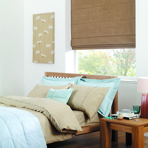 Light brown roman blind