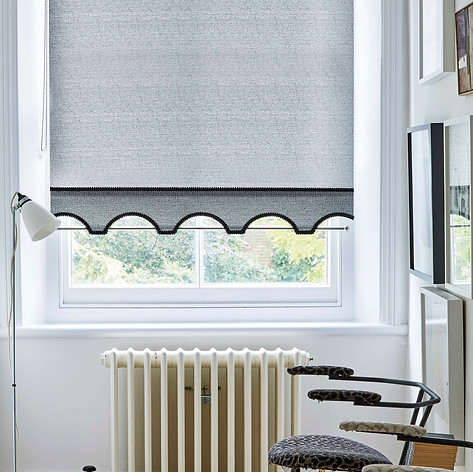 Gray roller blinds with a colonnade scallop, braiding and decorative pole