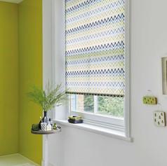 Light green and blue zig-zag patterned roller blind