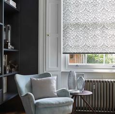 Light gray roller blinds