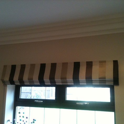 Brown striped roman blind
