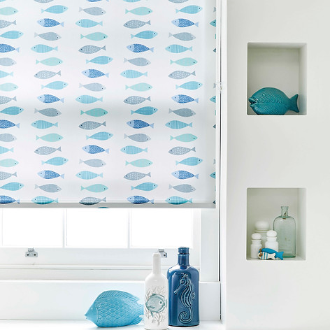 Light blue and white fish patterned roller blinds