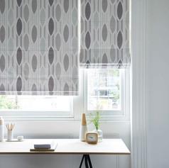 Light gray circular roman blinds