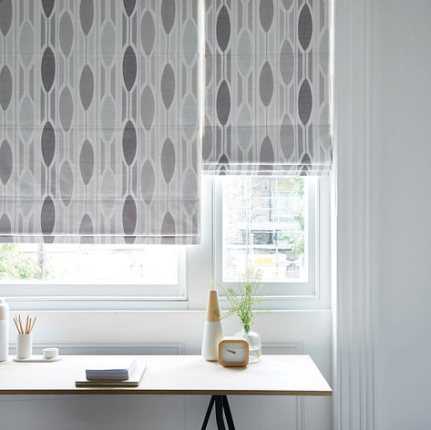 Light gray circular roman blinds