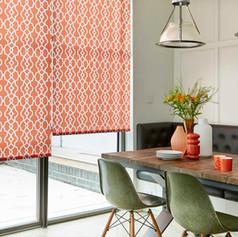 Orange patterned roller blinds