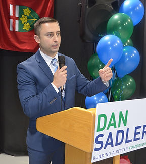 Dan Sadler speaking from behind a podium