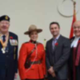 Dan Sadler with a veteran, RCMP officer and judge