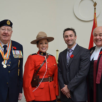 Dan Sadler with a veteran, RCMP officer and judge