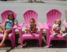 Dan Sadler's 3 daughters on chairs eating ice cream