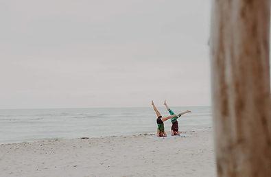 compressed sirsasana on beach.jpg