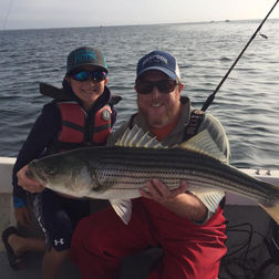 Captain Jeff with young angler and striper.