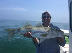 Angler with Striper