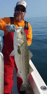 Captain Jeffry Craig wih Striped Bass on Zen Charters