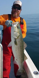 Captain Jeffry Craig wih Striped Bass on Zen Charters