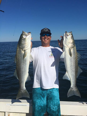 Fisherman with Striped Bass