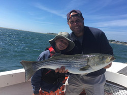 Anglers with Striped Bass
