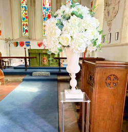 pedestals with urns and flowers