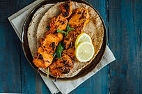 Delicious boneless chicken kebab on skewer served on arabic pita bread..jpg