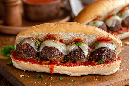 Meatball sandwich with tomato sauce and cheese on a hoagie roll.jpg