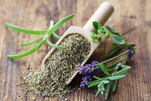 Herbs de Provence On A Wooden Background.jpg