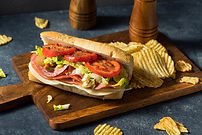 Homemade Cold Cut Italian Sub Sandwich with Salami Lettuce and Tomato.jpg