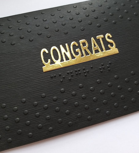 Black greetings card with Braille message reads ' Congrats' and embossed dots background