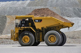 Cat_796_AC_mining_truck_hauling_load.5be