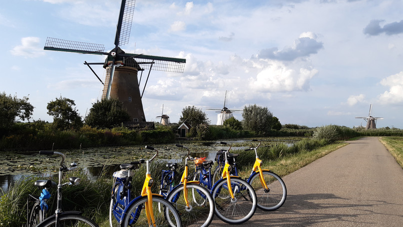 Cycle past the windmills at Kinderdijk, The Netherlands