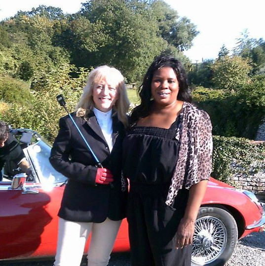 Kathy on set of Pearls of Africa with director Sharon Agina. Kathy was hired to portray an American wife.