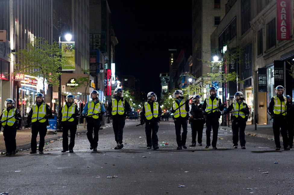 Two hours later, the riot squad closes down Ste. Catherine st. after looting occurs.