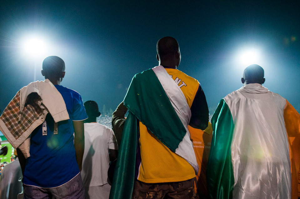 Ivorian immigrants in Ramat Gan watch their team face the Israeli national football team. 2008.