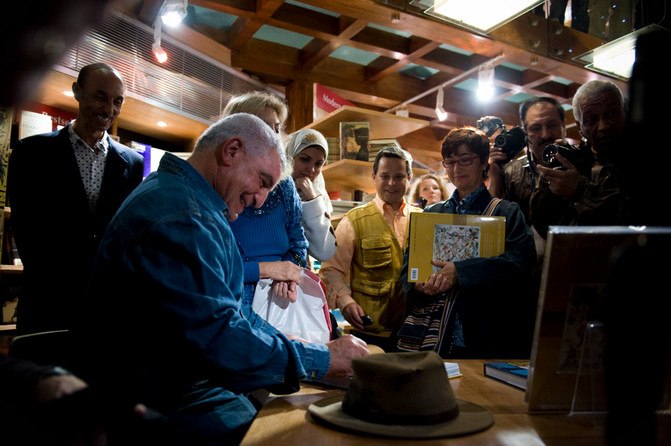Vice Minister of Culture Zahi Hawass basks in the spotlight at a book signing event in Cairo. 2009.