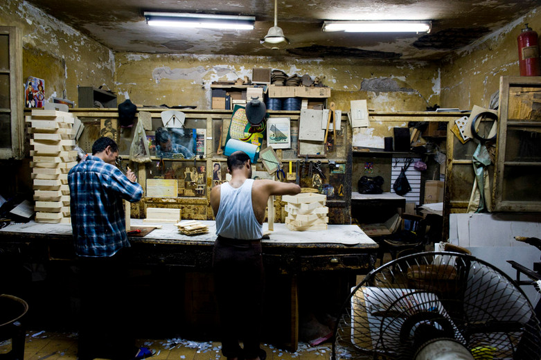 Workers make wooden boxes in a Cairo workshop by the Khan El Halili bazaar...