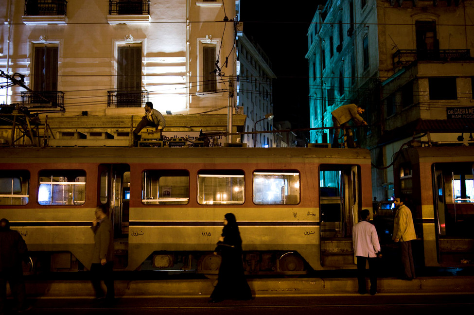 A woman looks wearily at a foreign camera crew in an Alexandria streetcar. 2009.