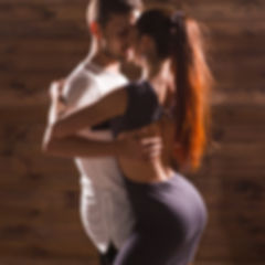 Active happy adults dancing bachata toge
