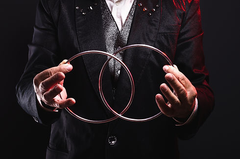 Magician shows trick with metal rings. S