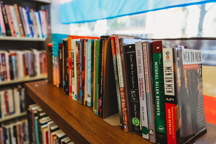 A bookshelf full of various LGBTQ Books available at the Library.
