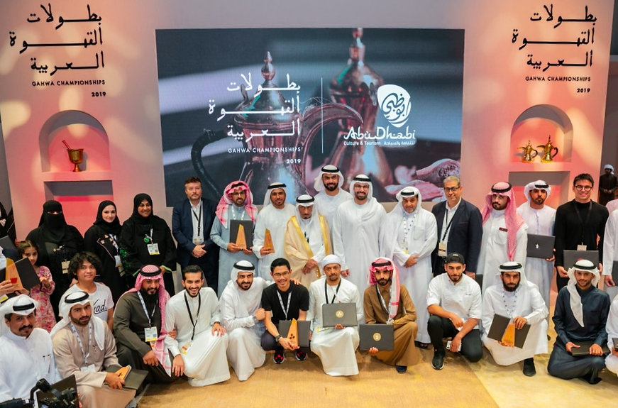 winners of the gahwa chamionship with Abu Dhabi Department of Culture & Tourism Chairman Mohammed Al Mubarak and