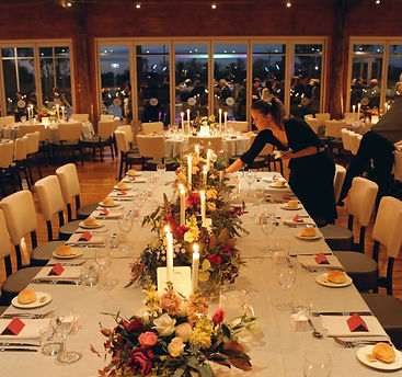 Wedding reception, flowers and candles night time table setting.