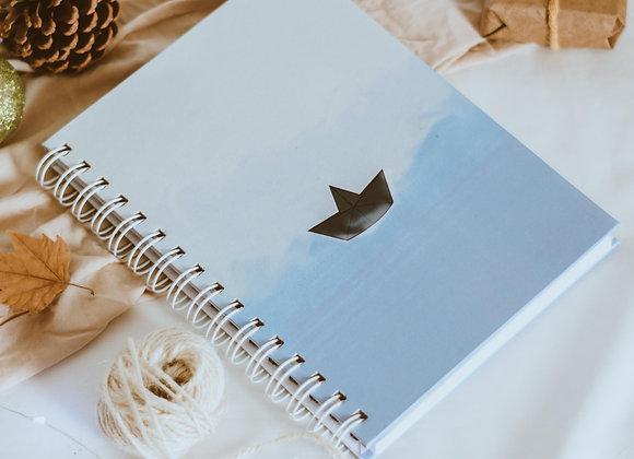 Caderno pautado Barquinho