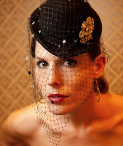 Black Mini Bowler Hat with silver and black spotted veiling