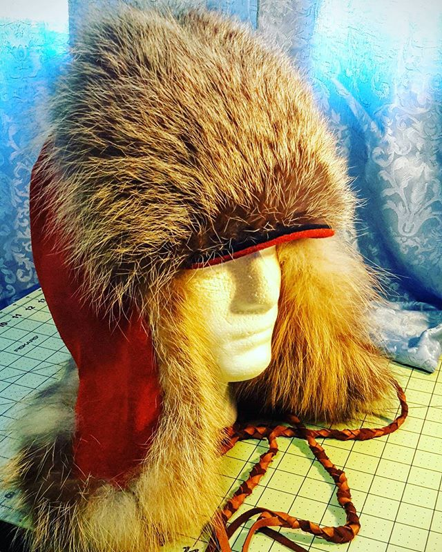 Kodiak island cross fox trapper hat with braided buckskin ties, size Medium #goldstandardfurs #hands
