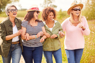 Group Of Mature Female Friends Walking A