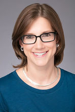 Catherine Hyde Townsend's headshot. She is smiling, wearing glasses and a teal shirt.