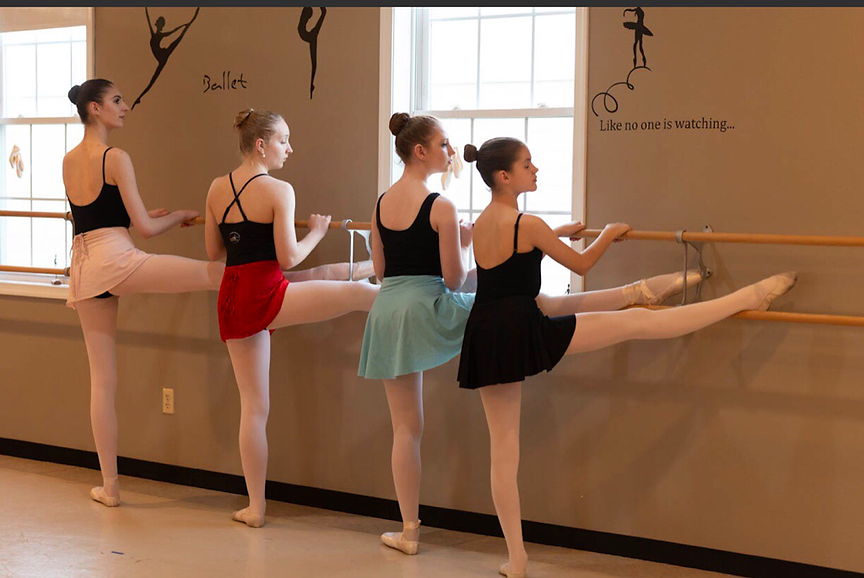 Advanced dancers at the barre