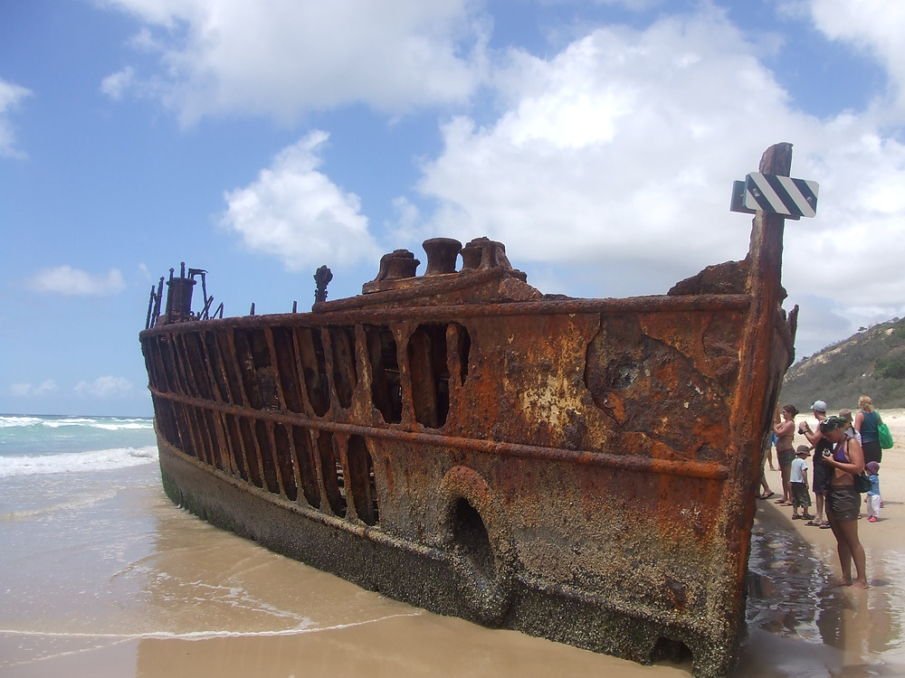 RUSTY BOAT ON BEACH